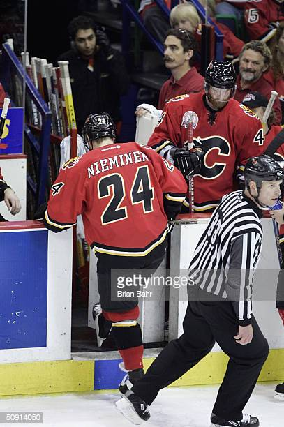Ville Nieminen of the Calgary Flames leaves the game after being ejected following an illegal hit he put on Vincent Lecavalier of the Tampa Bay...