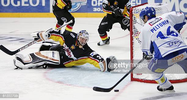 Ville Peltonen of Finland scores past Olaf Kolzig of Germany in the third period during an exhibition game of the World Cup of Hockey August 26 2004...