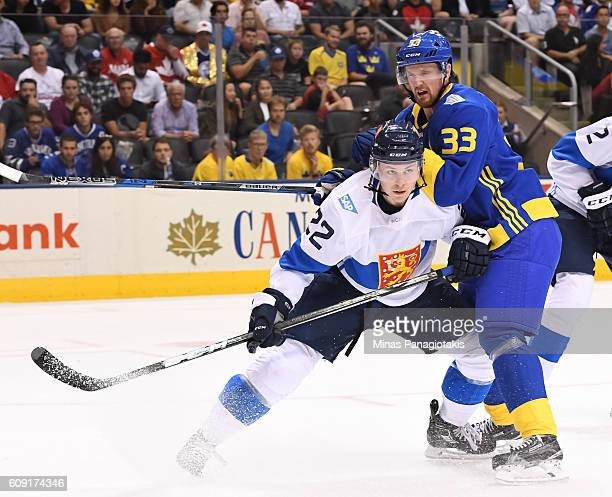 Ville Pokka of Team Finland battles for position with Henrik Sedin of Team Sweden during the World Cup of Hockey 2016 at Air Canada Centre on...