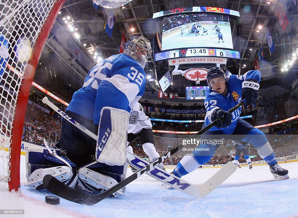 Ville Pokka #22 of Team Finland pushes the puck away from the goalline in front of Pekka Rinne #35 during the game against Team North America during the World Cup of Hockey tournament at the Air Canada Centre on September 18, 2016 in Toronto, Canada.