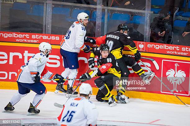 Ville Vainikainen and Saku Salminen of Lappeenranta challenges Linus Froberg and Kalle Rosen of Vaxjo during the Champions Hockey League Round of 16...