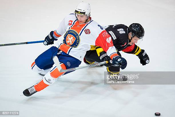 Ville Vainikainen of Lappeenranta challenges Philip Holm of Vaxjo during the Champions Hockey League Round of 16 match between SaiPa Lappeenranta and...