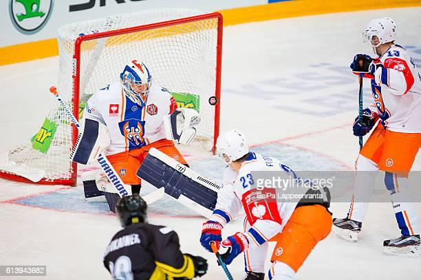 Ville Vainikainen of Lappeenranta challenges Teemu Lassila, Aleksi Elorinne and Valtteri Kemilainen of Tampere during the Champions Hockey League...
