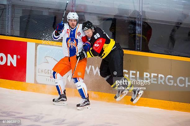Ville Vainikainen of Lappeenranta hits Tapio Sammalkangas of Tampere during the Champions Hockey League Round of 32 match between SaiPa Lappeenranta...
