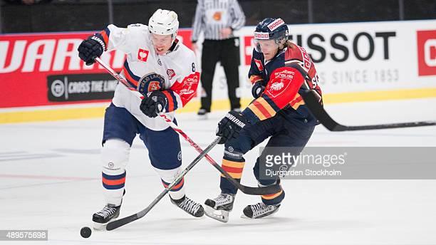 Ville Varakas of Vaxjo vs Marcus Sorensen of Djurgarden during the Champions Hockey League round of thirty-two game between Djurgarden Stockholm and...