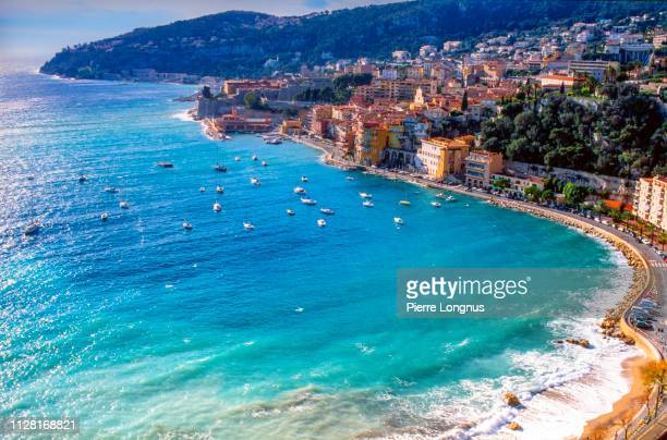 villefranche sur mer and its bay on the french riviera, on a windy winter day - french riviera stock pictures, royalty-free photos & images
