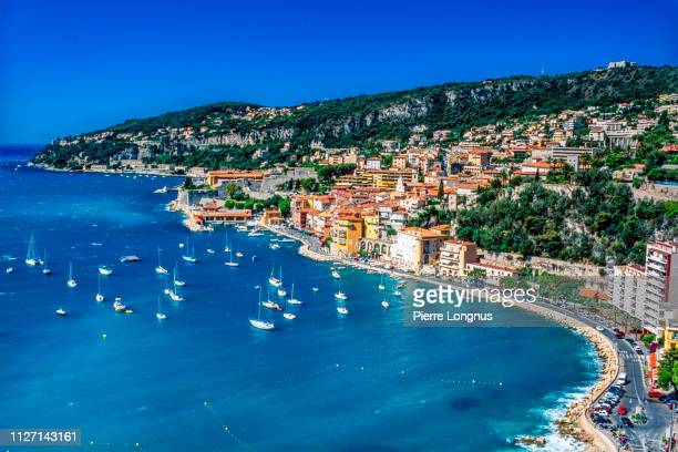 villefranche sur mer and its bay on the french riviera - france stock pictures, royalty-free photos & images