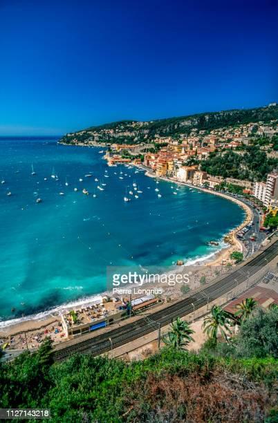villefranche sur mer and its bay on the french riviera - bateau de plaisance photos et images de collection