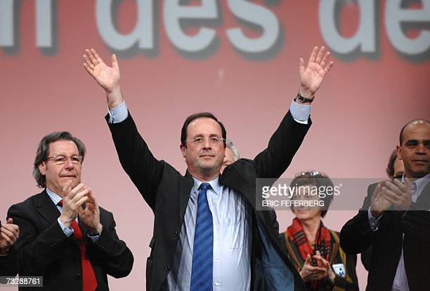 French Socialist Party's Prime Secretary Francois Hollande waves to the crowd at a Socialist party meeting, launching presidential candidate's...