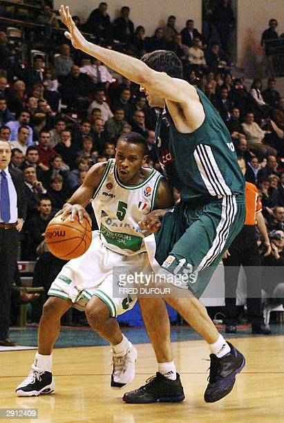 Villeurbanne's David Frigout vies with Trevise's Tyus Edney from USA during their Euroleague Basketball match 29 January 2004 at Astroballe in...