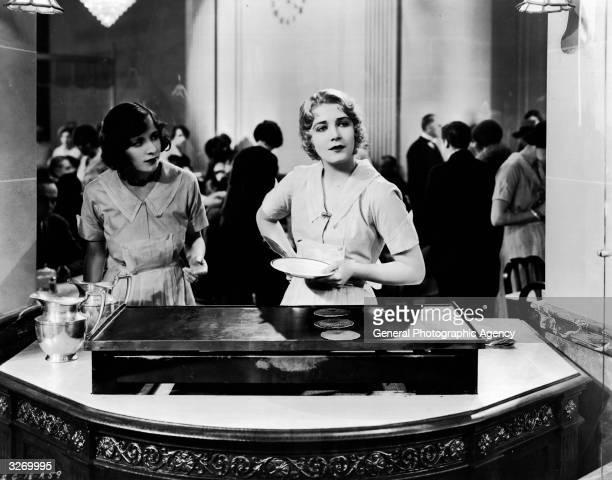 Vilma Banky serves pancakes in a scene from the film 'Fifth Avenue' directed by Al Santell for Samuel Goldwyn Studios