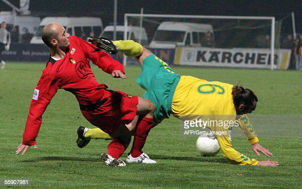 Belgium's Tonathen Walasiak scores past Lithuania's Aidas Preiksaitis during a soccer World Cup 2006 European zone Group Seven qualifying match at...