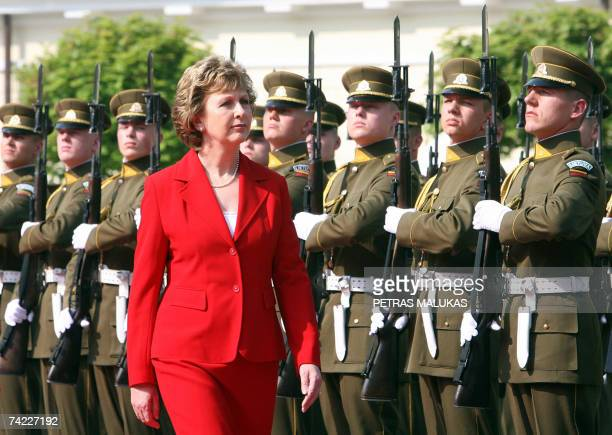 Irish President Mary McAleese reviews an honor guard at the Presidential Palace in Vilnius 23 May 2007 at the start of her three-day state visit to...