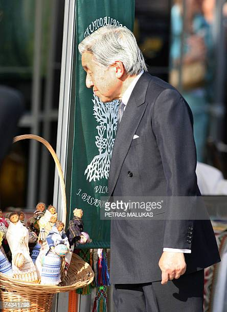 Japanese Emperor Akihito looks on during a visit to a local craftswork exhibition in Vilnius 26 May 2007 The Japanese imperial couple rrived in...