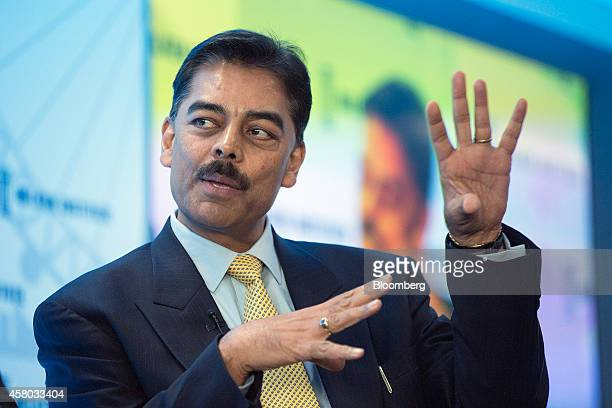 Vimal Shah chief executive officer of Bidco Group gestures as he speaks during the Milken Institute London summit in London UK on Tuesday Oct 28 2014...
