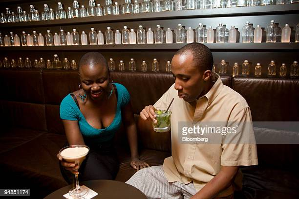 Vimbai Matsikidze left and Chris Michev drink an espresso martini and a mojito in the Delicatessen basement bar in New York US on Thursday Sept 4...