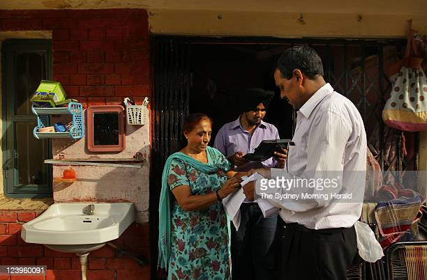 Vimla Devi is interviewed at her home in Chandgrah India by data entry operator Aman Preet Singh and enumerator Arun Kumar for the caste census The...