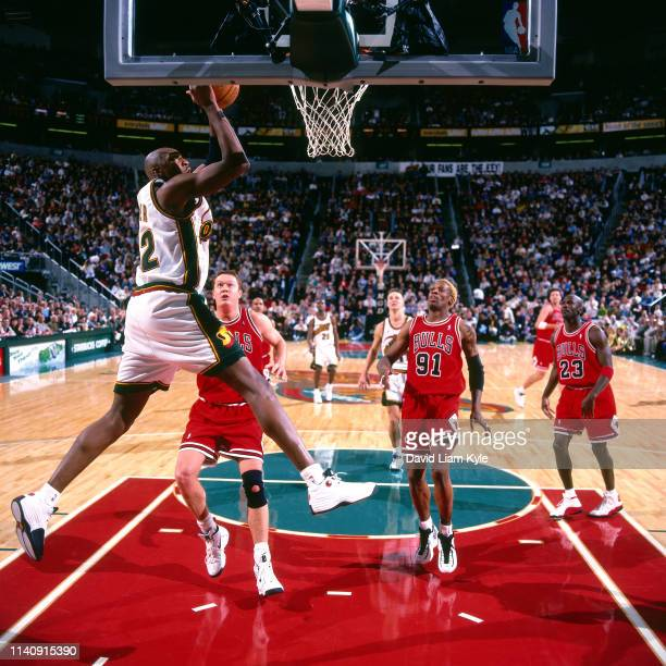 Vin Baker drives to the basket during the game against the Chicago Bulls on November 11 1997 at the KeyArena at Seattle Center in Seattle Washington...