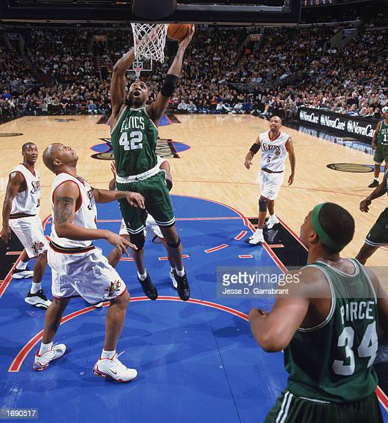 Vin Baker of the Boston Celtics goes up for the shot over Derrick Coleman of the Philadelphia 76ers during the game at First Union Center on December...