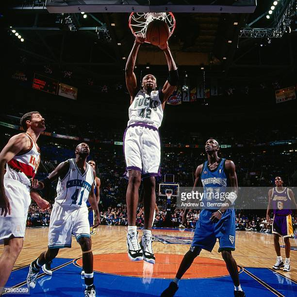 Vin Baker of the Eastern Conference dunks against Kevin Garnett of the Eastern Conference during the 1997 AllStar Game on February 9 1997 at Gund...
