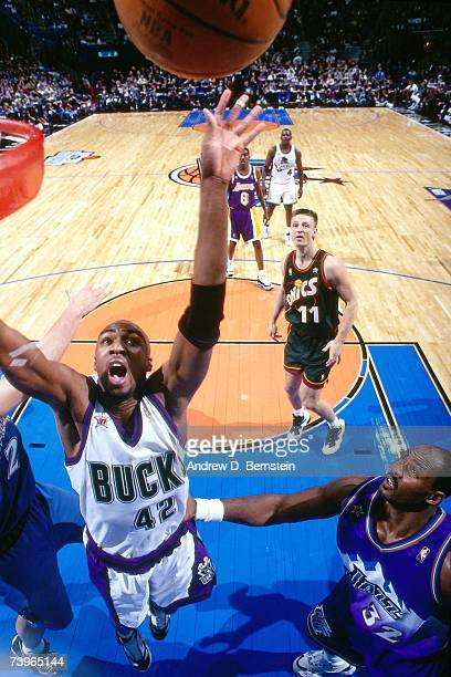 Vin Baker of the Eastern Conference grabs the rebound against Karl Malone of the Western Conference during the 1997 AllStar Game on February 9 1997...