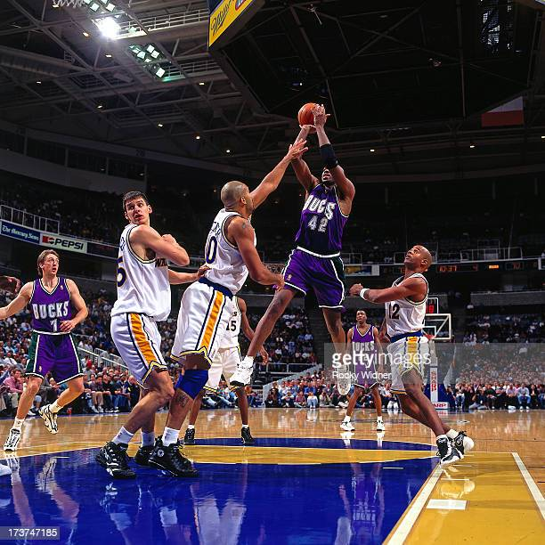 Vin Baker of the Milwaukee Bucks attempts a shot against Felton Spencer of the Golden State Warriors during a game played on November 14 1996 at San...