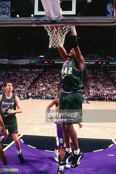 Vin Baker of the Milwaukee Bucks dunks against the Sacramento Kings during a game played on March 13 1996 at the Arco Arena in Sacramento California...