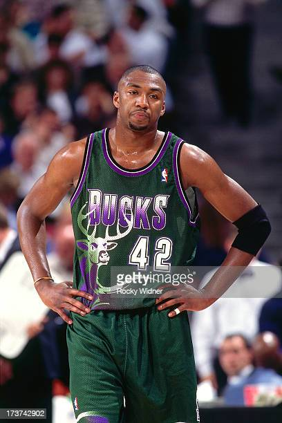 Vin Baker of the Milwaukee Bucks looks on against the Sacramento Kings during a game played on March 13 1996 at the Arco Arena in Sacramento...