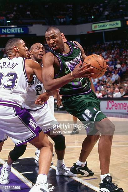 Vin Baker of the Milwaukee Bucks posts up against Brian Grant of the Sacramento Kings during a game played on March 13 1996 at the Arco Arena in...