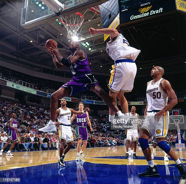 Vin Baker of the Milwaukee Bucks shoots a layup against the Golden State Warriors during a game played on November 14 1996 at San Jose Arena in San...