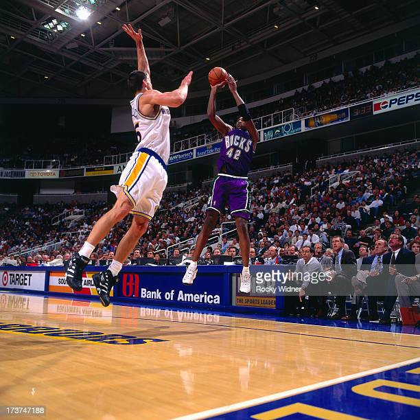 Vin Baker of the Milwaukee Bucks shoots against Andrew DeClercq of the Golden State Warriors during a game played on November 14 1996 at San Jose...