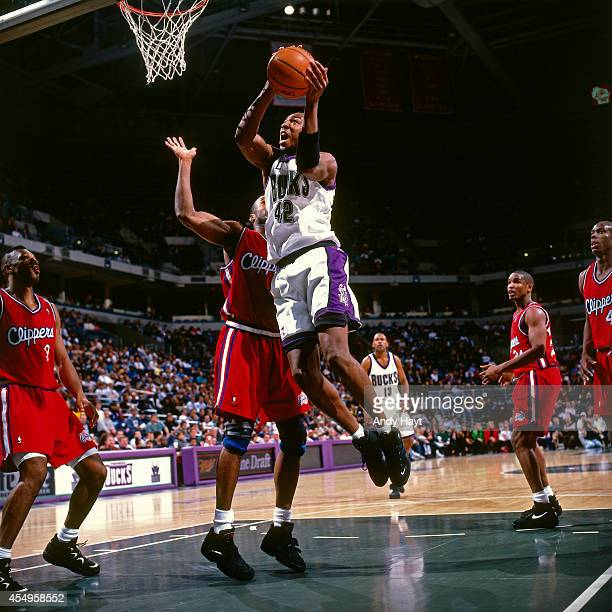 Vin Baker of the Milwaukee Bucks shoots against the Los Angeles Clippers circa 1995 at the Bradley Center in Milwaukee Wisconsin NOTE TO USER User...