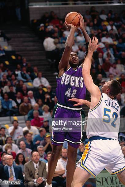 Vin Baker of the Milwaukee Bucks shoots against Todd Fuller of the Golden State Warriors during a game played on November 14 1996 at San Jose Arena...