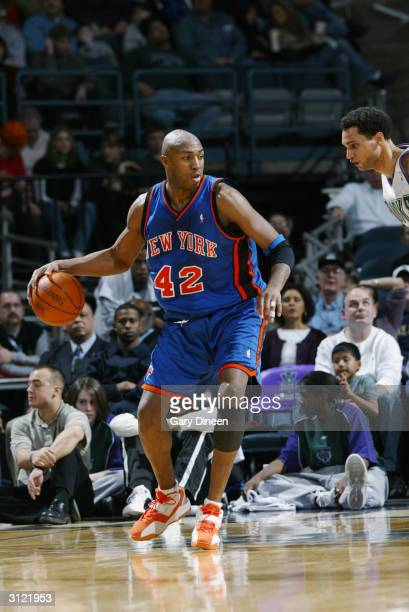 Vin Baker of the New York Knicks is defended by Dan Gadzuric of the Milwaukee Bucks during the game at Bradley Center on March 14 2004 in Milwaukee...