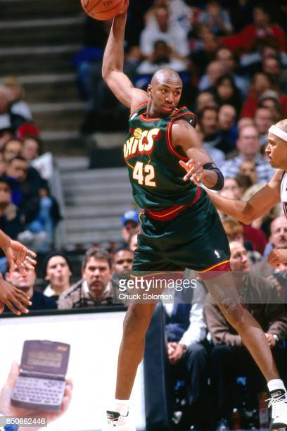 d1200f4efb6a Vin Baker of the Seattle SuperSonics catches a pass against the New Jersey  Nets at Continental