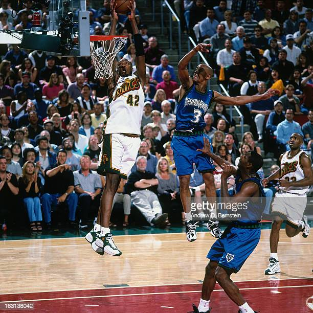 Vin Baker of the Seattle Supersonics dunks against the Minnesota Timberwolves in Game Five of the Western Conference Quarterfinals as part of the...