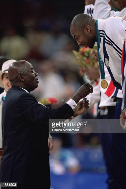 Vin Baker of the USA receives his gold medal during the ceremony after the men's basketball game against France at the Sydney SuperDome during the...