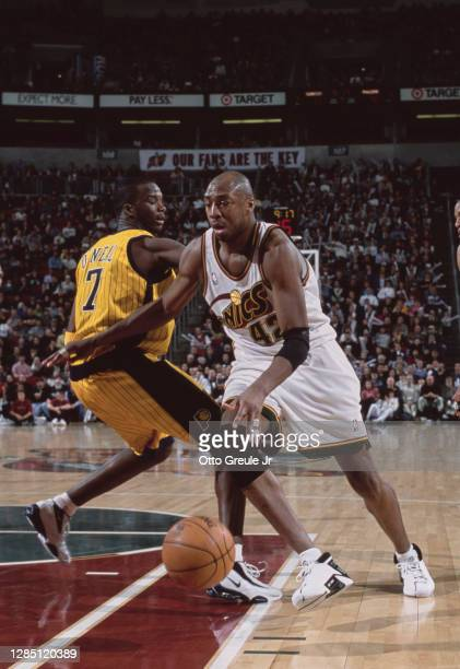 Vin Baker, Power Forward for the Seattle SuperSonics dribbles the basketball around Jermaine O'Neal of the Indiana Pacers during their NBA Midwest...