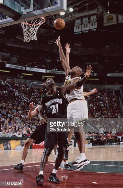 Vin Baker, Power Forward for the Seattle SuperSonics shoots for the basket above Kevin Garnett of the Minnesota Timberwolves during their NBA Midwest...
