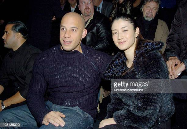 Vin Diesel and Koyuki Kato during Giorgio Armani Spring Summer 2005 Collection Front Row and Backstage at Pier 94 in New York City New York United...