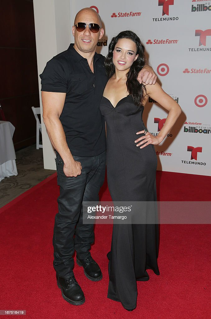 Vin Diesel and Michelle Rodriguez pose backstage at Billboard Latin Music Awards 2013 at Bank United Center on April 25, 2013 in Miami, Florida.