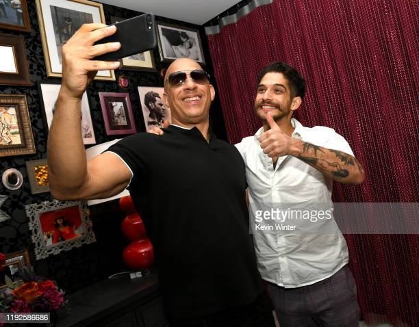 Vin Diesel and Tyler Posey pose at the after party for the premiere of Netflix's Fast And Furious Spy Racers at CityWalk Hollywood on December 07...