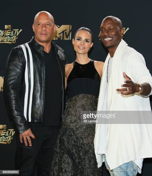Vin Diesel Jordana Brewster Tyrese Gibson pose in the press room at the 2017 MTV Movie and TV Awards at The Shrine Auditorium on May 7 2017 in Los...