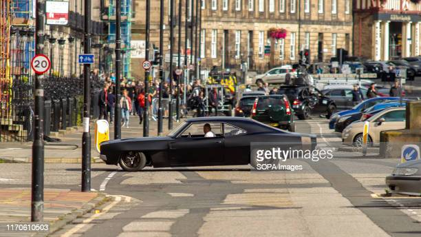 Vin Diesel's standin drives his car as it drives across the street during the filming Fast Furious 9 has wrapped production in Edinburgh after...