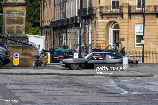 Vin Diesel's standin drives his car down the street during the filming Fast Furious 9 has wrapped production in Edinburgh after several weeks of...