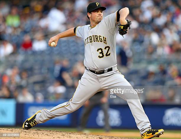 Vin Mazzaro of the Pittsburgh Pirates delivers a pitch in the eighth inning against the New York Yankees on May 17 2014 at Yankee Stadium in the...