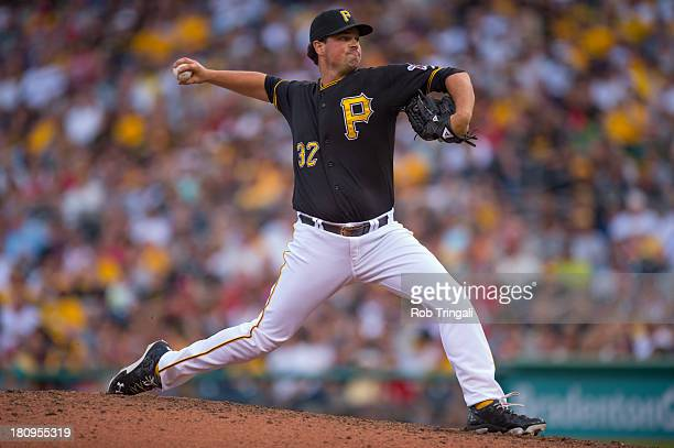 Vin Mazzaro of the Pittsburgh Pirates pitches during game one of a twilight doubleheader against the St Louis Cardinals at PNC Park on July 30 2013...