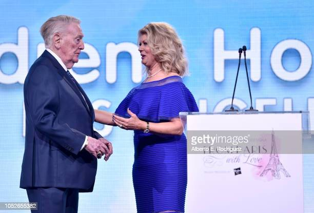 Vin Scully and Mary Hart onstage at the 2018 Children's Hospital Los Angeles 'From Paris With Love' Gala at LA Live on October 20 2018 in Los Angeles...