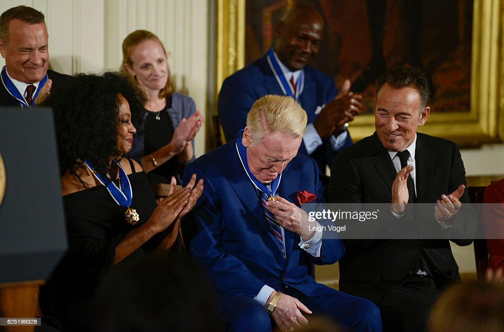Vin Scully looks at his medal after being presented with the 2016 Presidential Medal Of Freedom by President Obama at the White House on November 22, 2016 in Washington, DC.