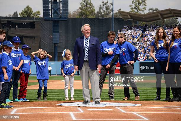 Vin Scully stands infront of his grandchildren during opening day pre game ceremonies at a baseball game between the San Fransico Giants and the Los...
